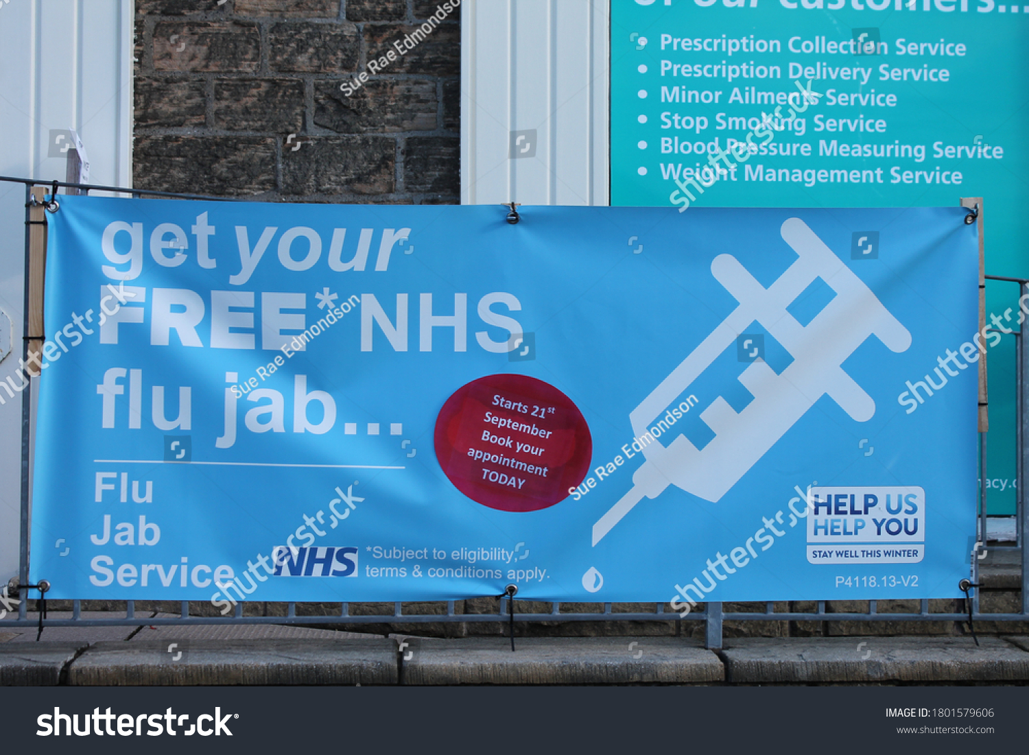 Upholland, Lancashire, UK, 24/08/2020: Flu jab sign outside pharmacy