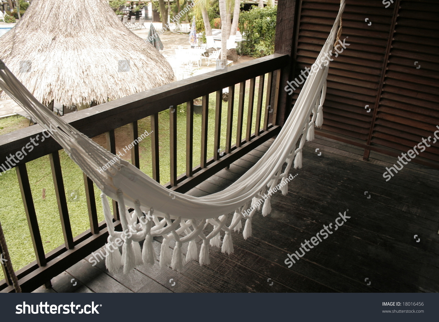 White hammock on balcony stock photo 18016456 shutterstock for Balcony hammock