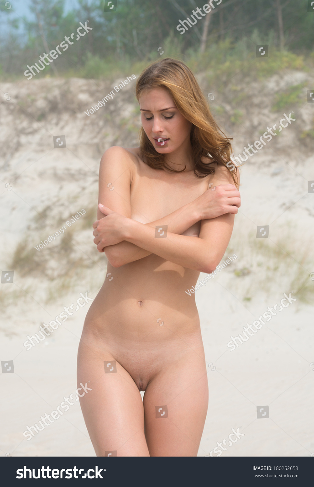 Young Naked Woman On A Sandy Beach On A Foggy Day