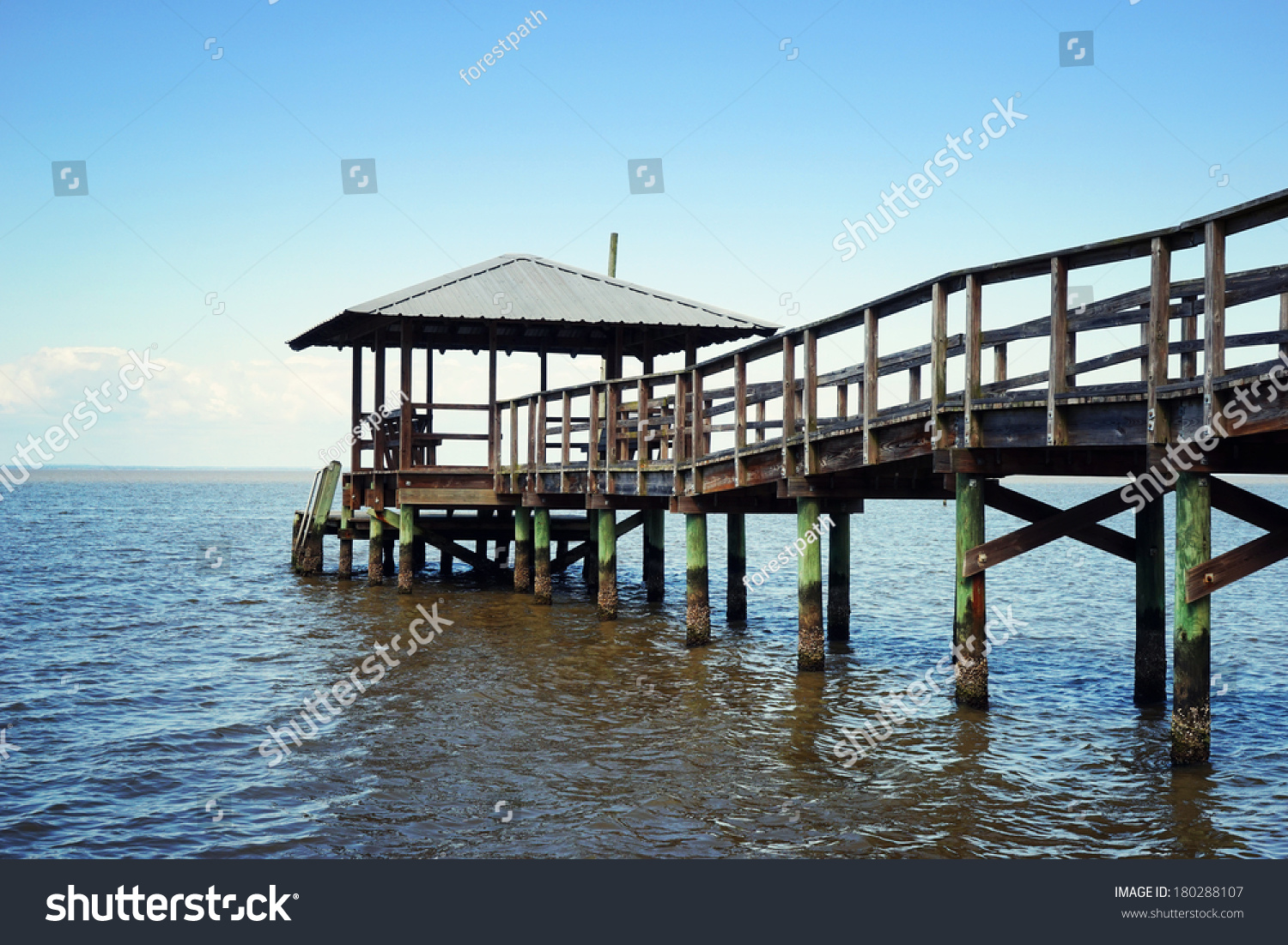 Rustic vintage wooden fishing and swimming pier off the for Fishing off a pier