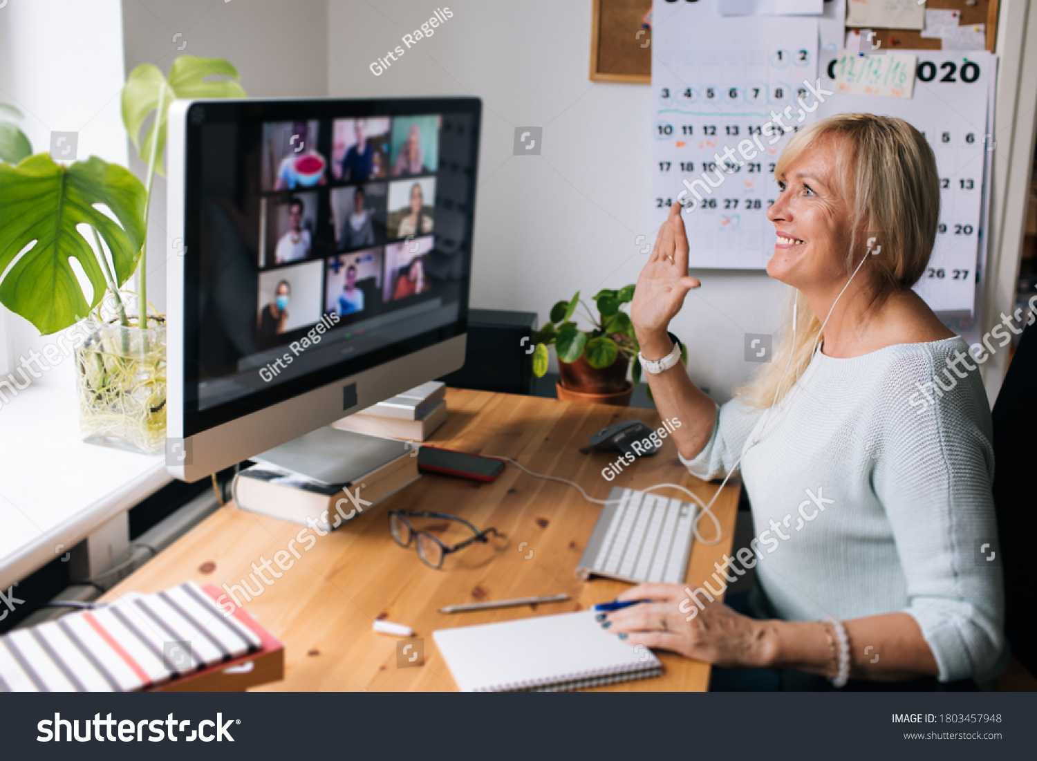 Online training teacher. Day to day new normal office Work from home. Smiling mature woman having video call via laptop in the studio flat office. Daily routine. Business video conferencing.  #1803457948