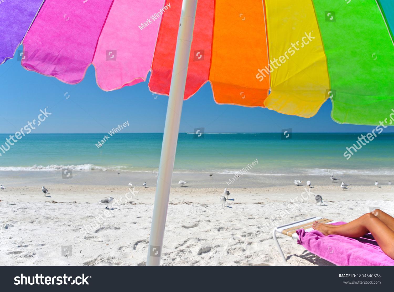 stock-photo-a-multi-clored-beach-umbrell