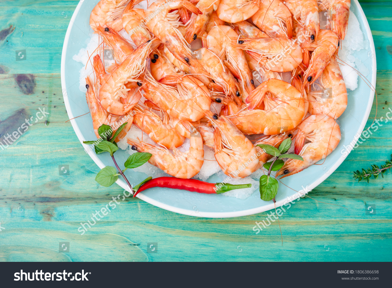 stock-photo-cooked-prawns-on-a-green-woo