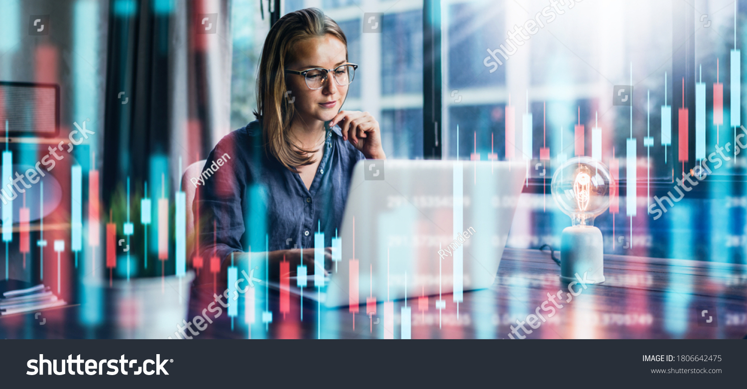 Young woman working at modern office.Technical price graph and indicator, red and green candlestick chart and stock trading computer screen background. Double exposure. Trader analyzing data #1806642475