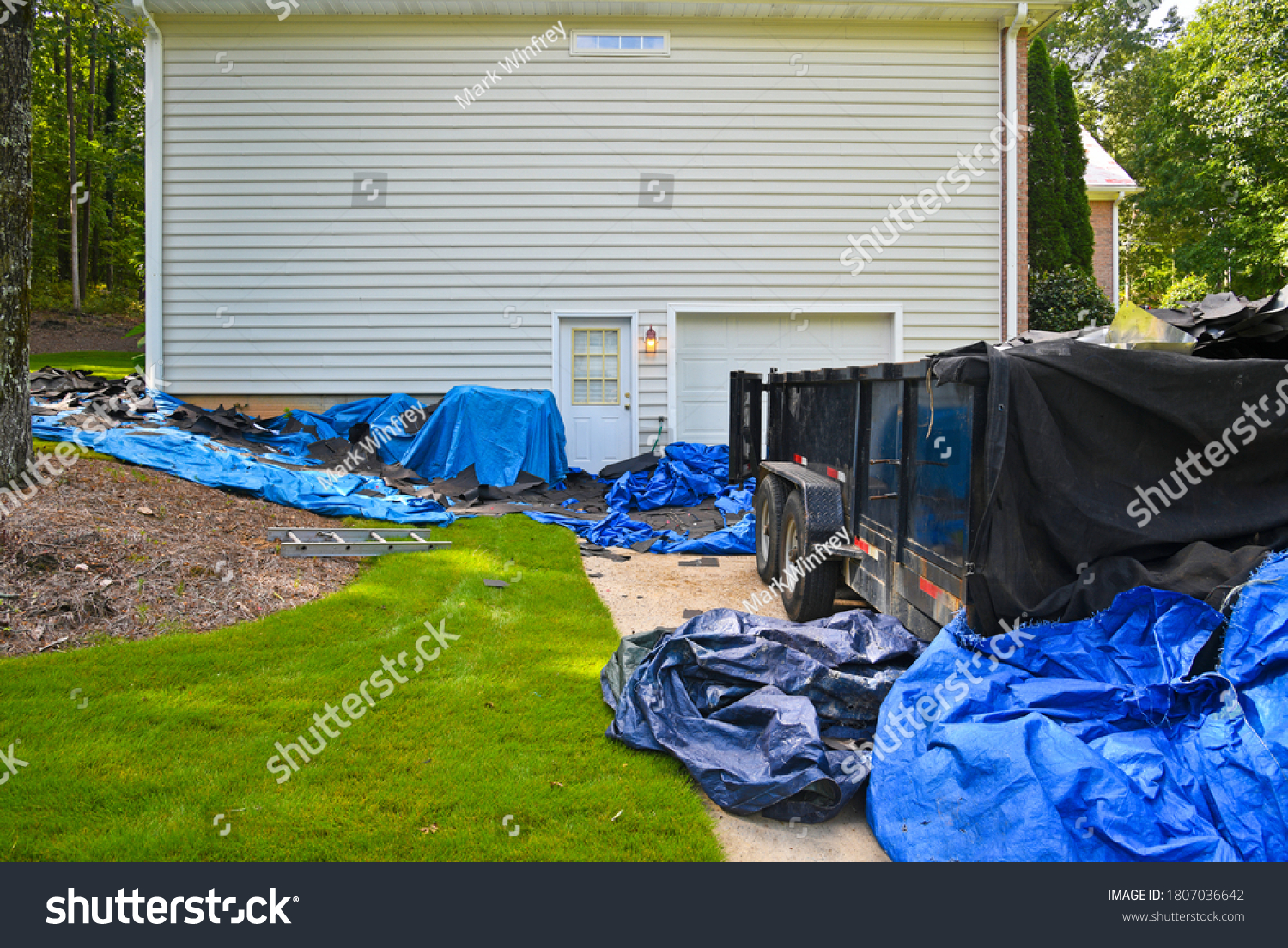 stock-photo-tarps-and-dumpster-placed-at