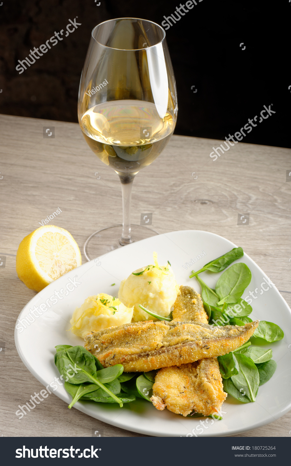 Dinner fish fillet potato young spinach stock photo for White wine with fish