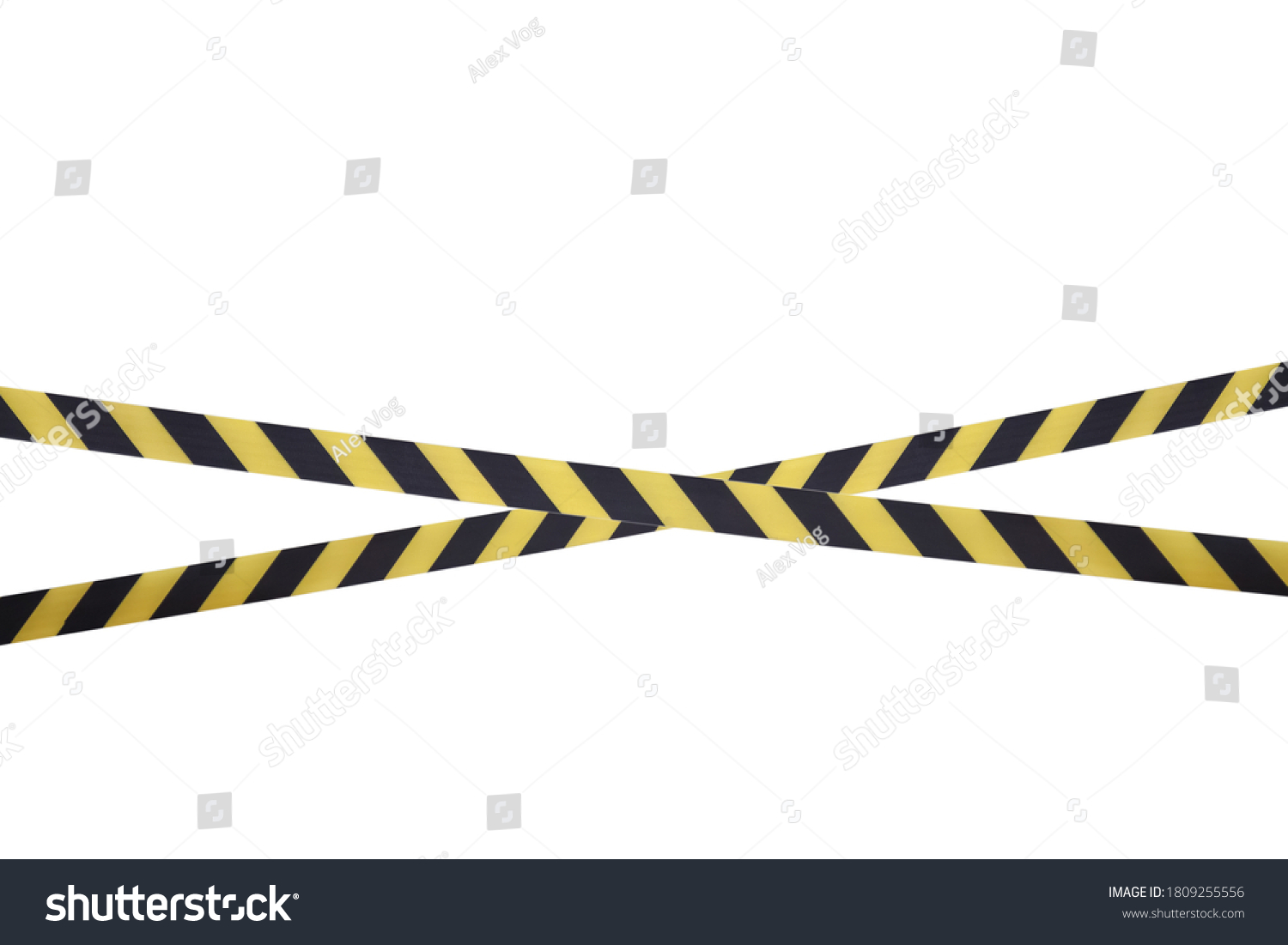Black and yellow lines of barrier tape prohibit passage. Barrier tape on white isolate. Barrier that prohibits traffic. Warning tape. Danger unsafe area warning do not enter. Concept of no entry #1809255556
