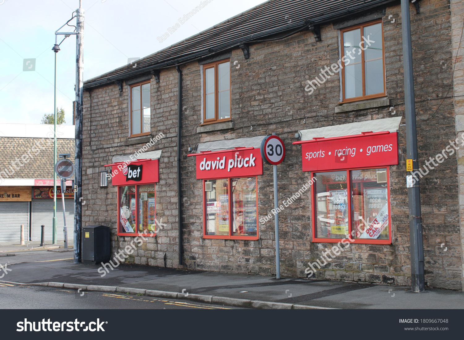Upholland, Lancashire, UK, 06/09/2020 :  Exterior of David Pluck betting shop, north west independent bookmakers