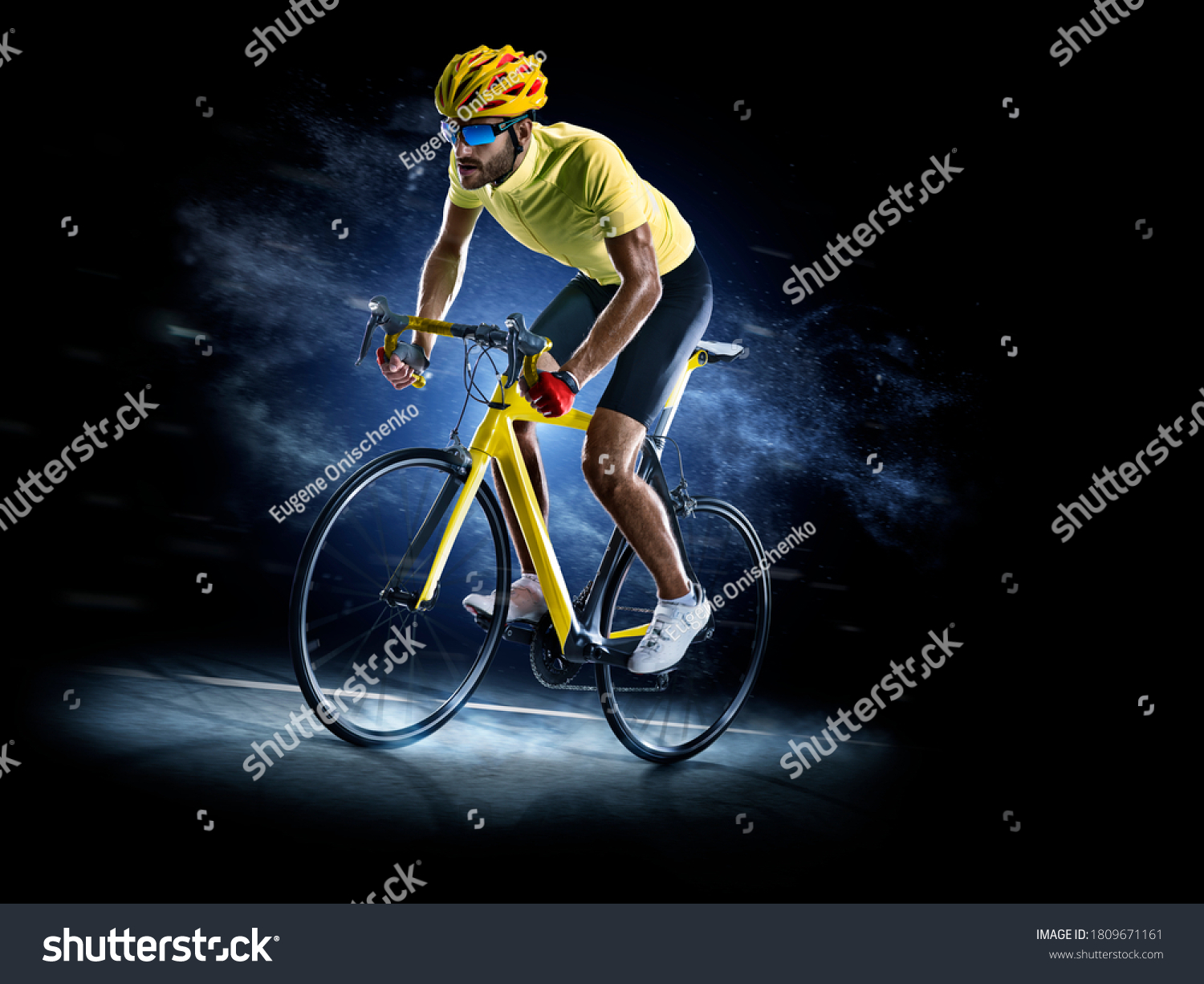 Professional road bicycle racer in action isoated on the black background #1809671161