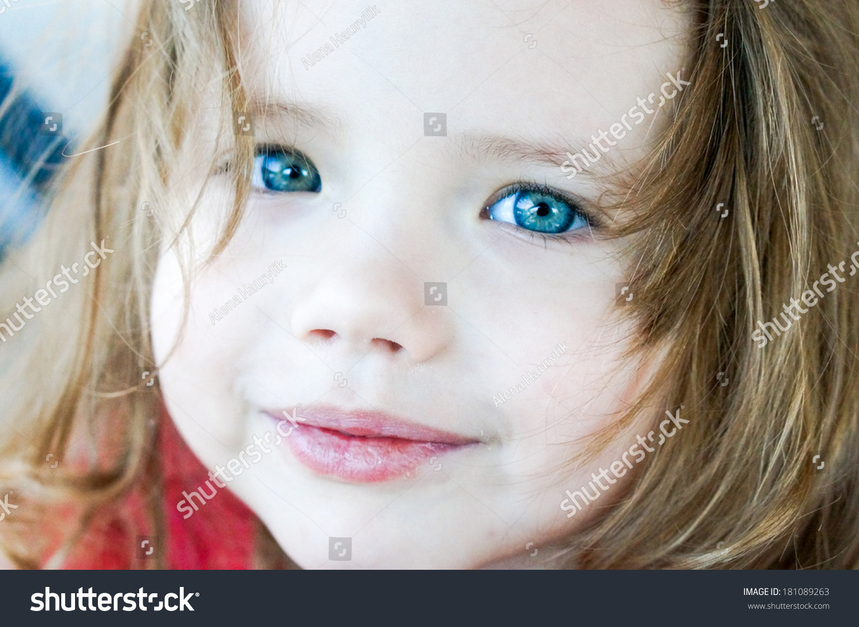 closeup cute baby girl blue eyes stock photo (edit now) 181089263