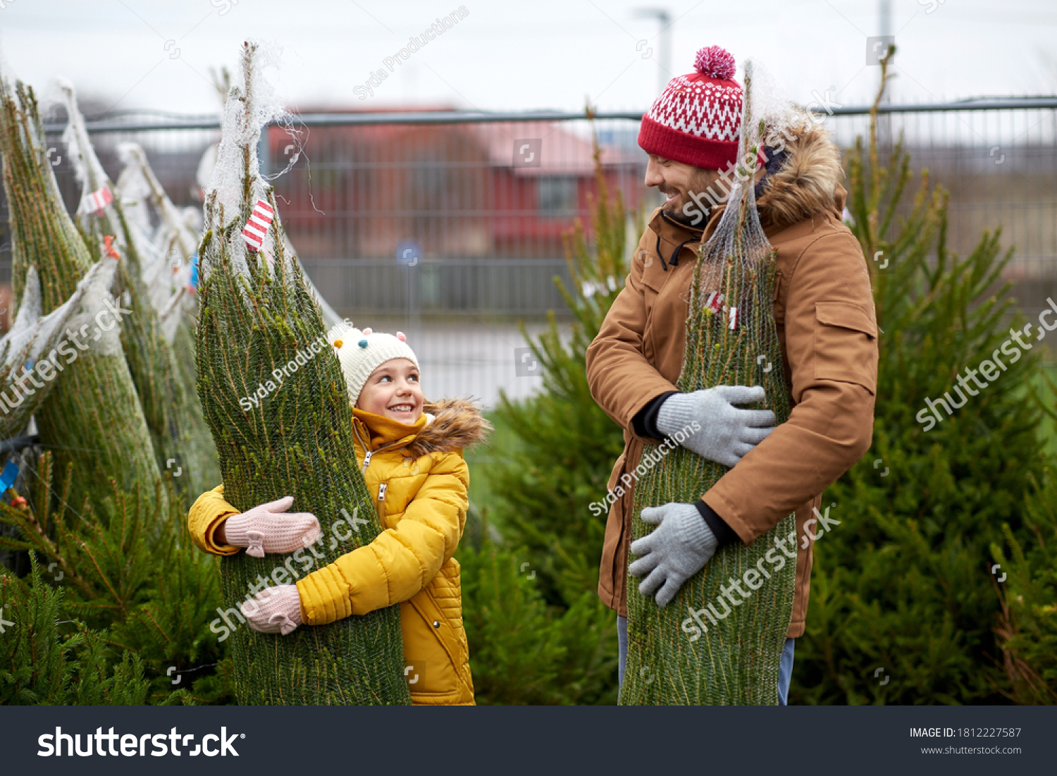 family, winter holidays and people concept - happy father and little daughter buying christmas tree at street market #1812227587