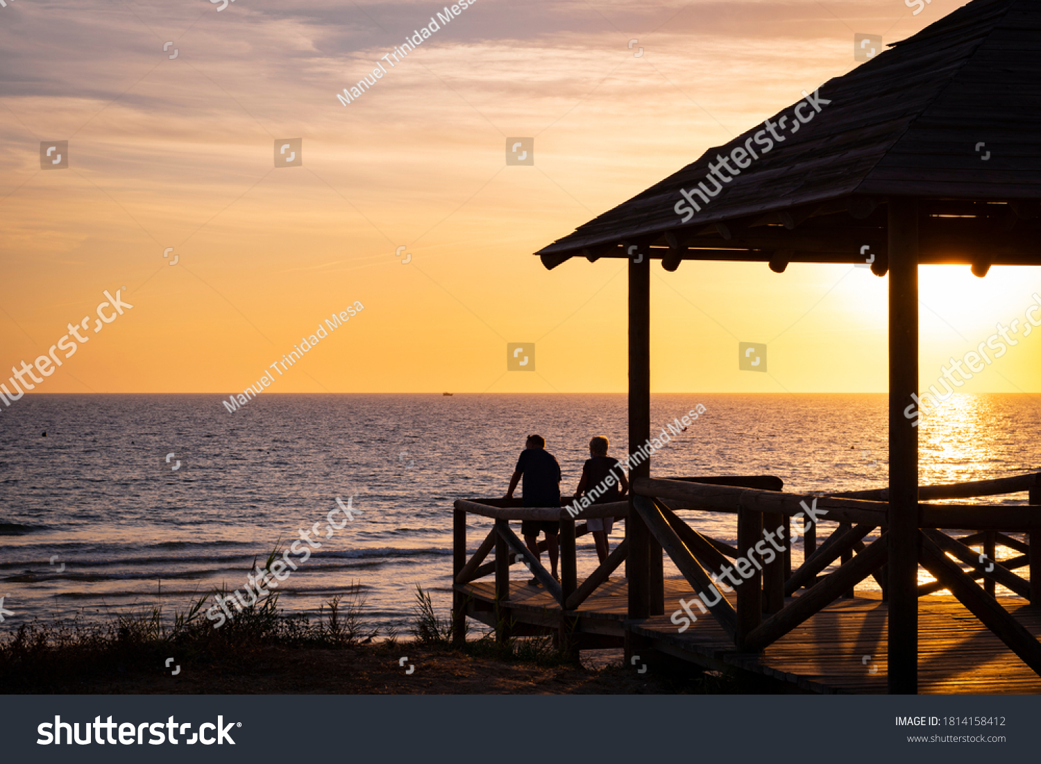 stock-photo-couple-looking-at-the-sunset