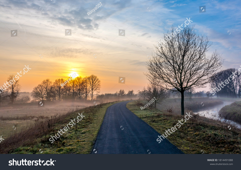 Morning sun in autumn sunrise fog #1814491088