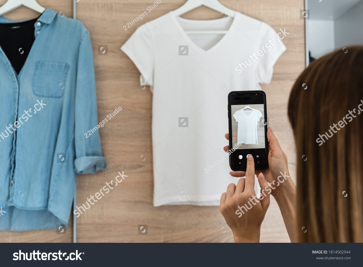 Woman taking picture of used clothes. Selling used clothes concept.  #1814502944