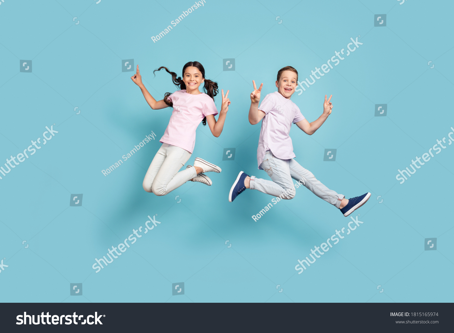 Full length body size view of her she his he nice attractive small little cheerful cheery friends friendship kids jumping showing v-sign having fun isolated over blue pastel color background #1815165974