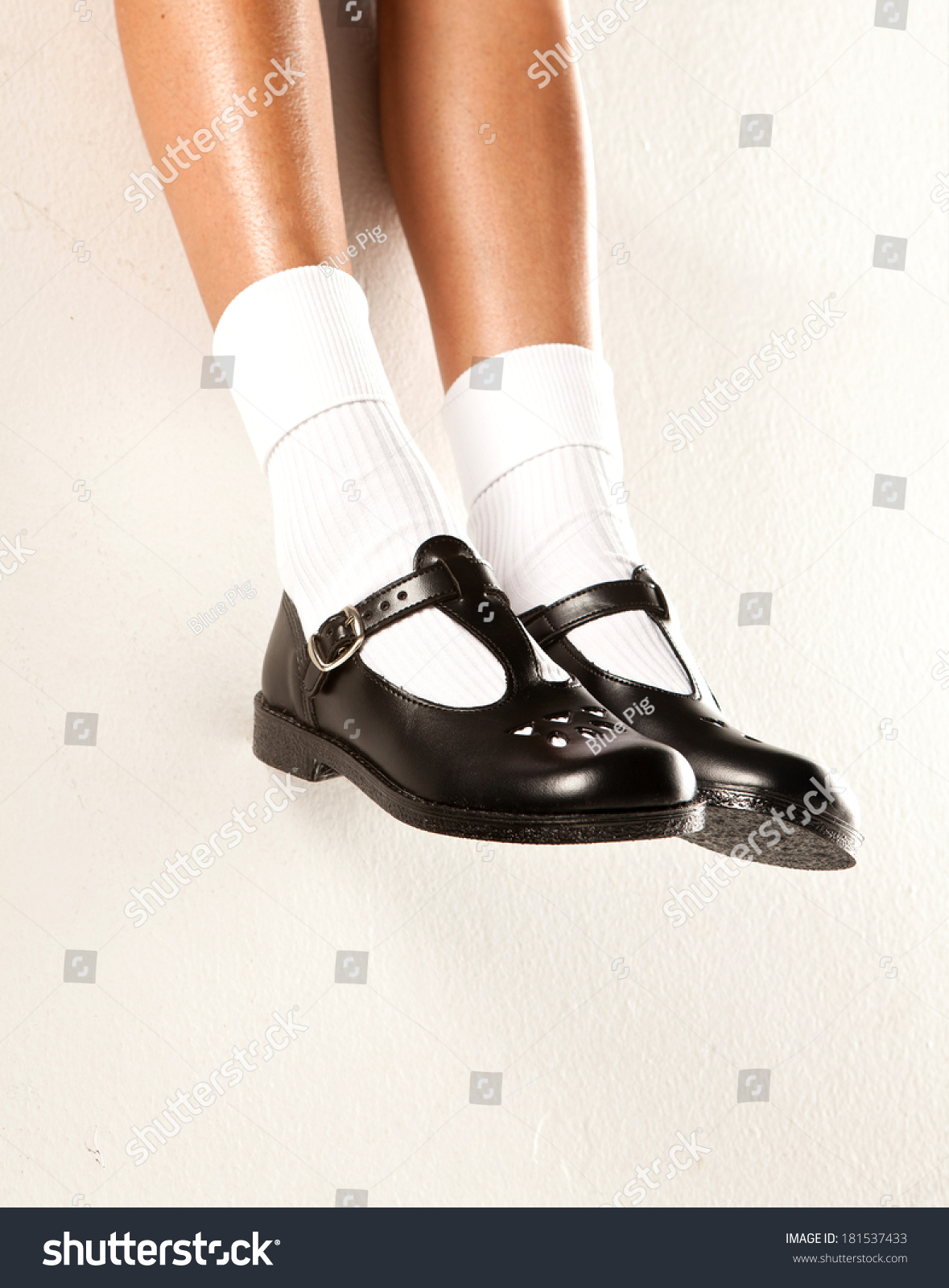 4a8fe96bd616 A dangling set of kids legs with short white socks and black girls school  shoes on