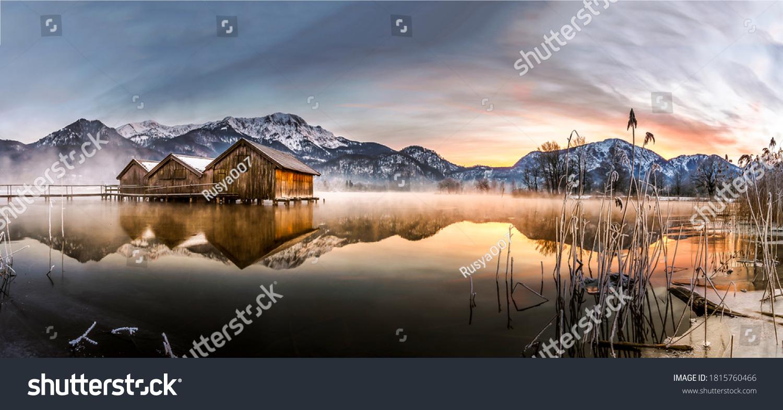 Winter mountain lake panorama. Orange dawn nature panoramic landscape #1815760466
