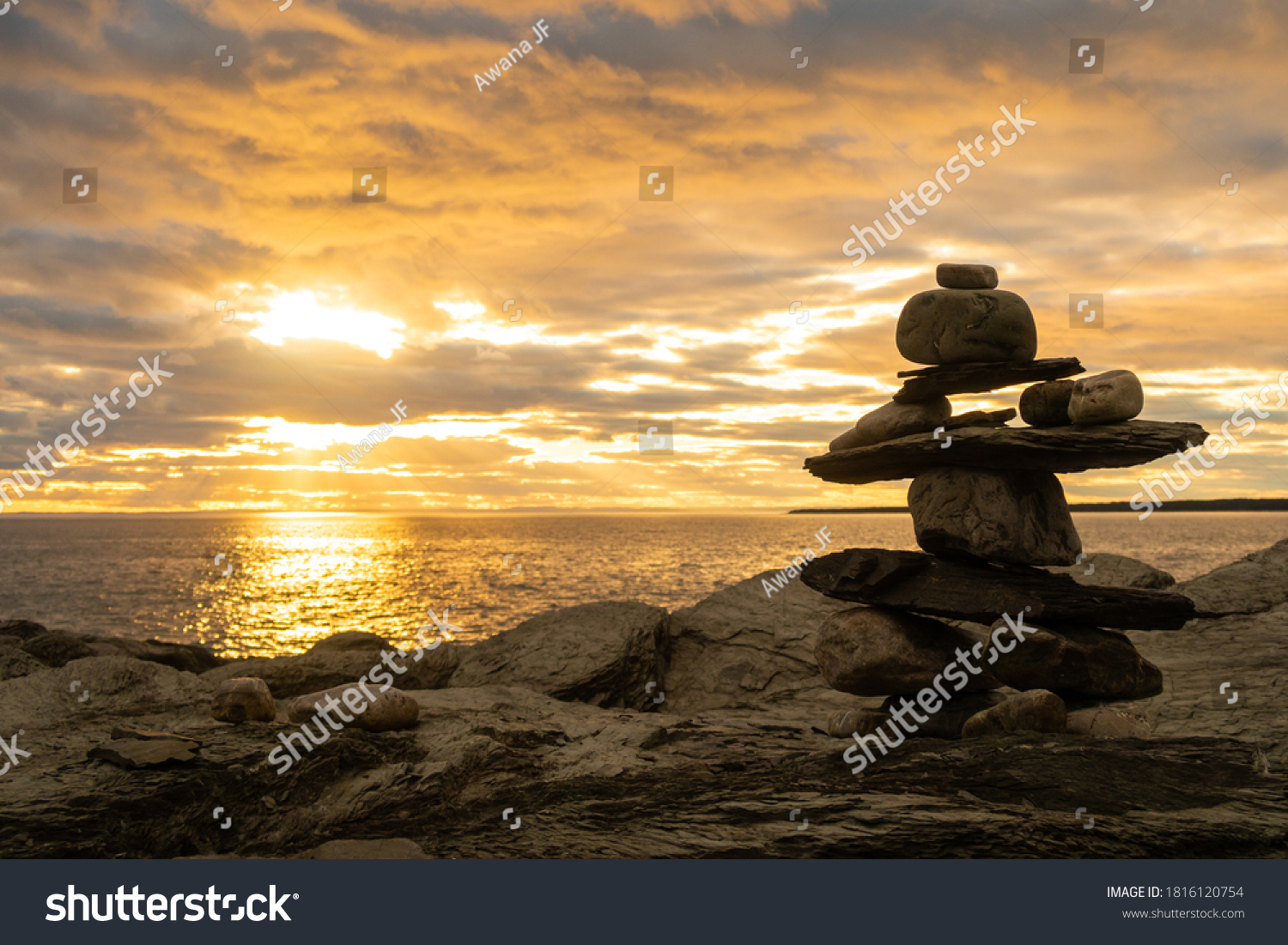 stock-photo-view-of-an-inukshuk-on-a-roc