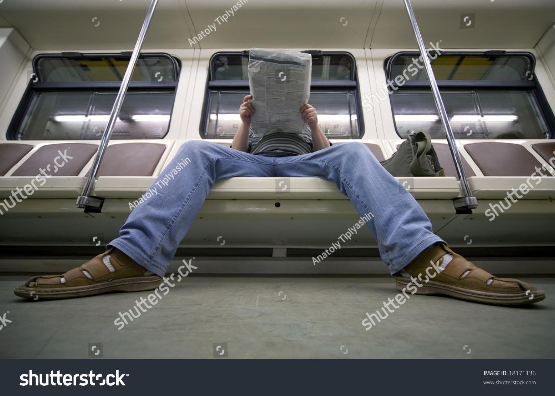Businessman reading newspaper in metro carriage stock photo 18171136 shutterstock - Carrage metro ...