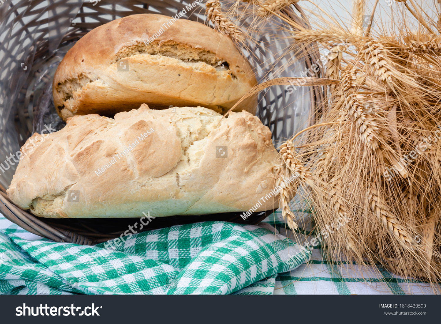 Two pieces of homemade bread inside a wicker basket