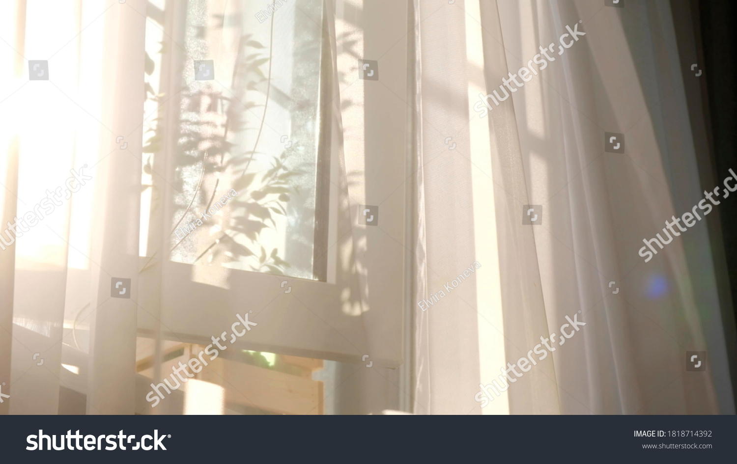 wind blows through the open window in the room. Waving white tulle near the window. Morning sun lighting the room, shadow background overlays. #1818714392