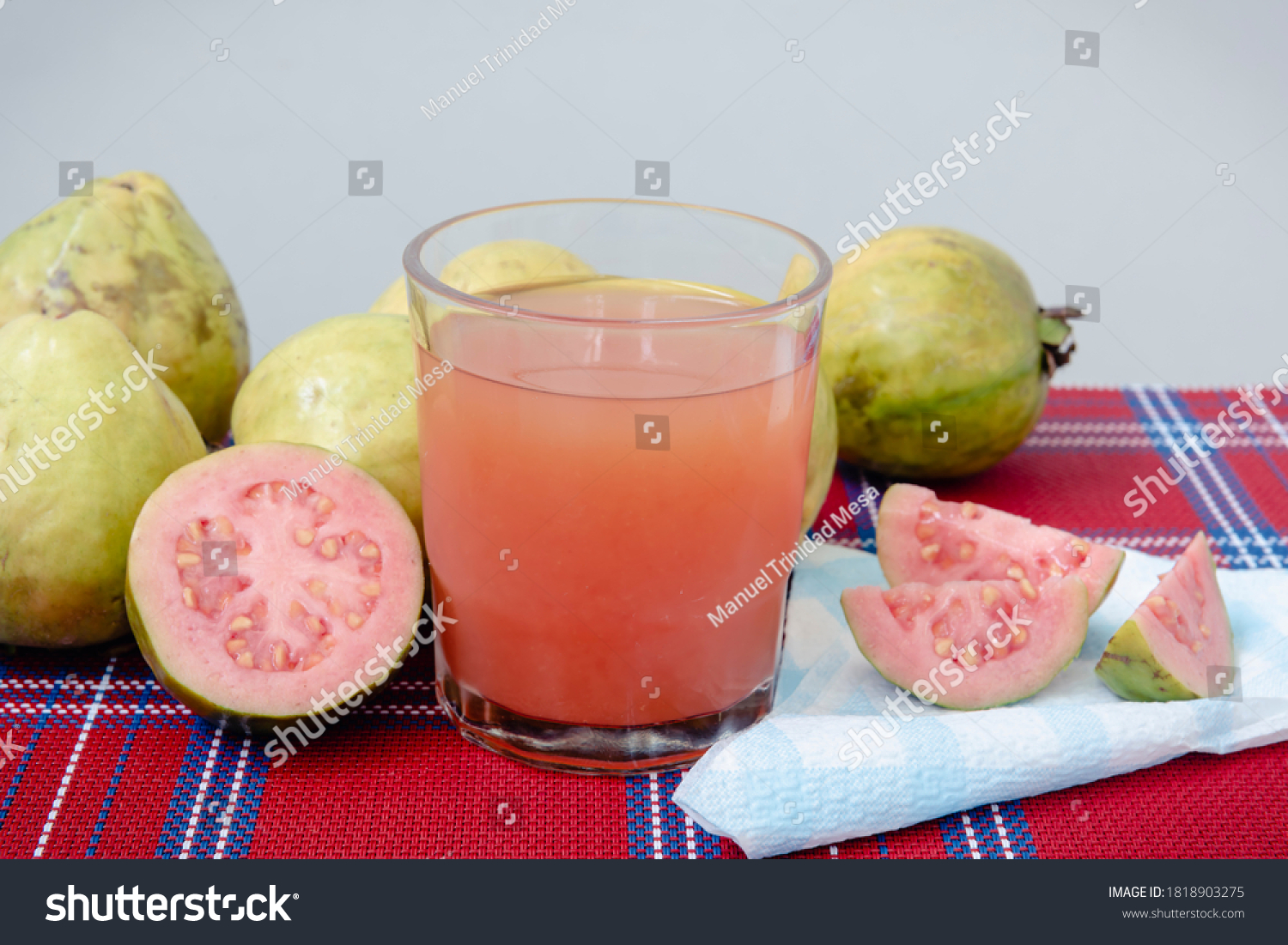 stock-photo-glass-of-guava-juice-next-to