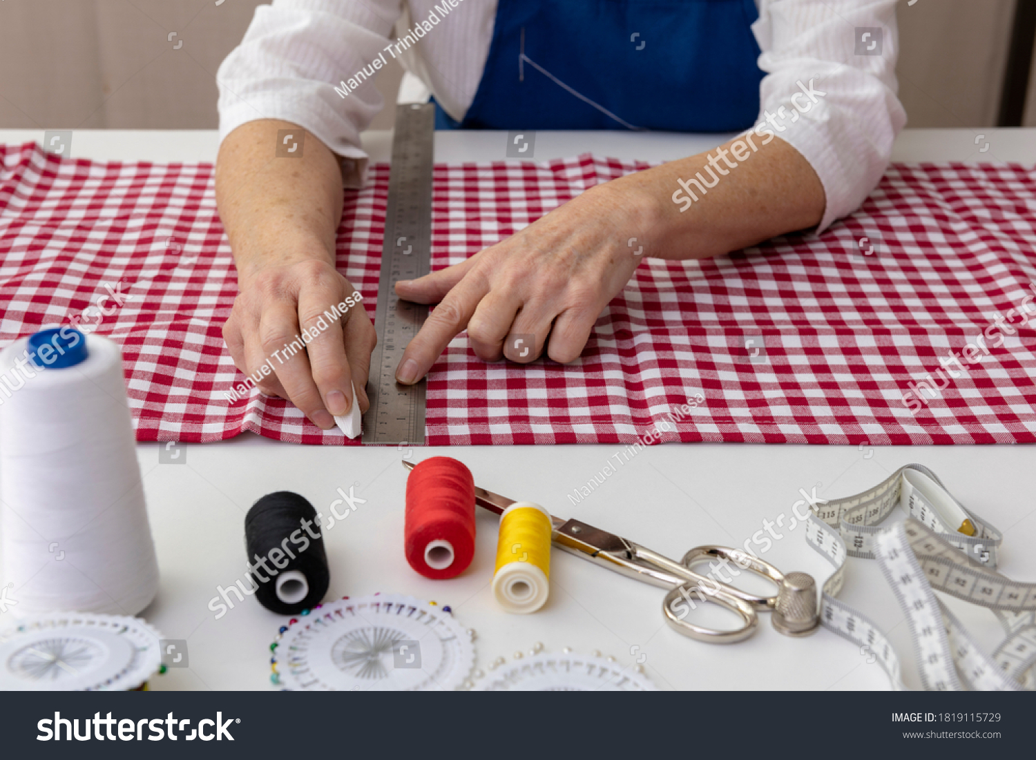 stock-photo-seamstress-marks-fabric-with