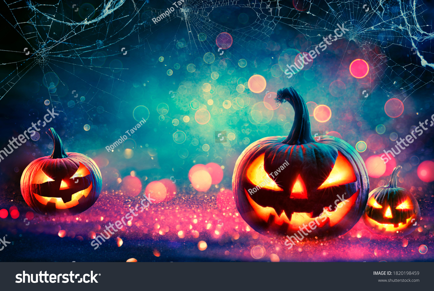 Halloween Abstract Party - Smiling Pumpkins On Defocused Shiny Background  #1820198459