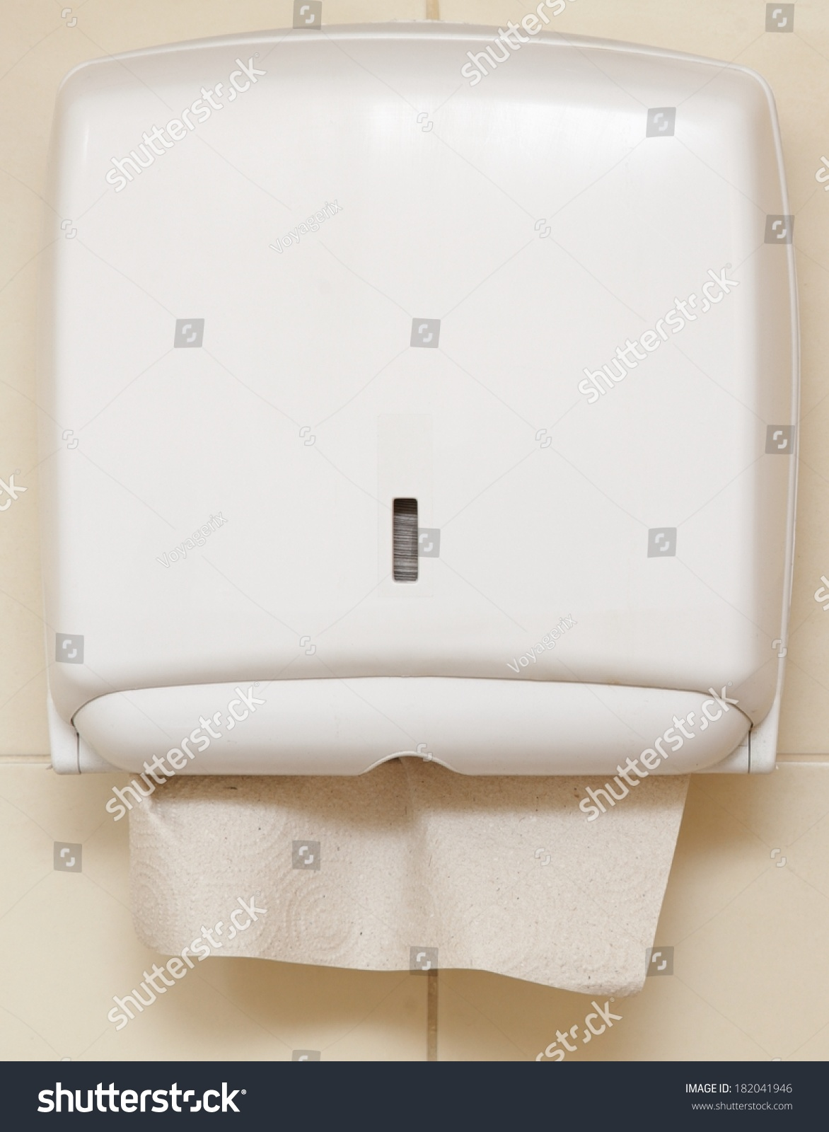 Paper towel dispenser on the wall in the bathroom stock for Wall paper in bathroom