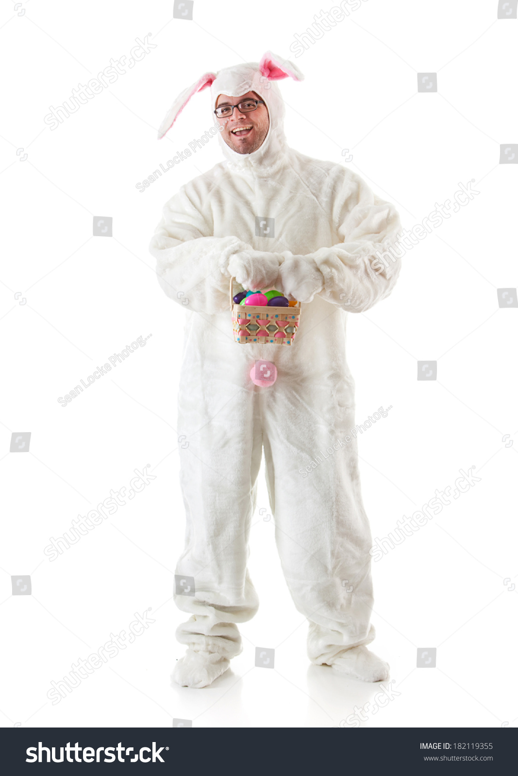 Bunny man rabbit suit holding easter stock photo royalty free bunny man in rabbit suit holding easter basket of eggs negle