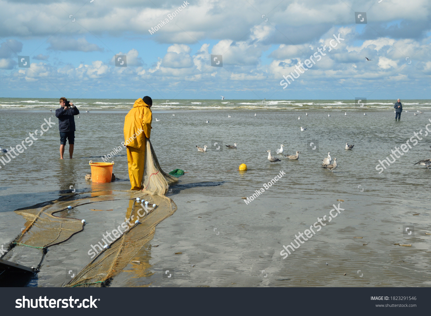 East Duinkerk,Belgium,September 2017, a fisherman looks his equipment