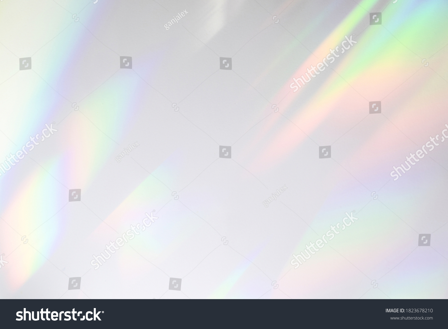 Blurred rainbow light refraction texture overlay effect for photo and mockups. Organic drop diagonal holographic flare on a white wall. Shadows for natural light effects #1823678210