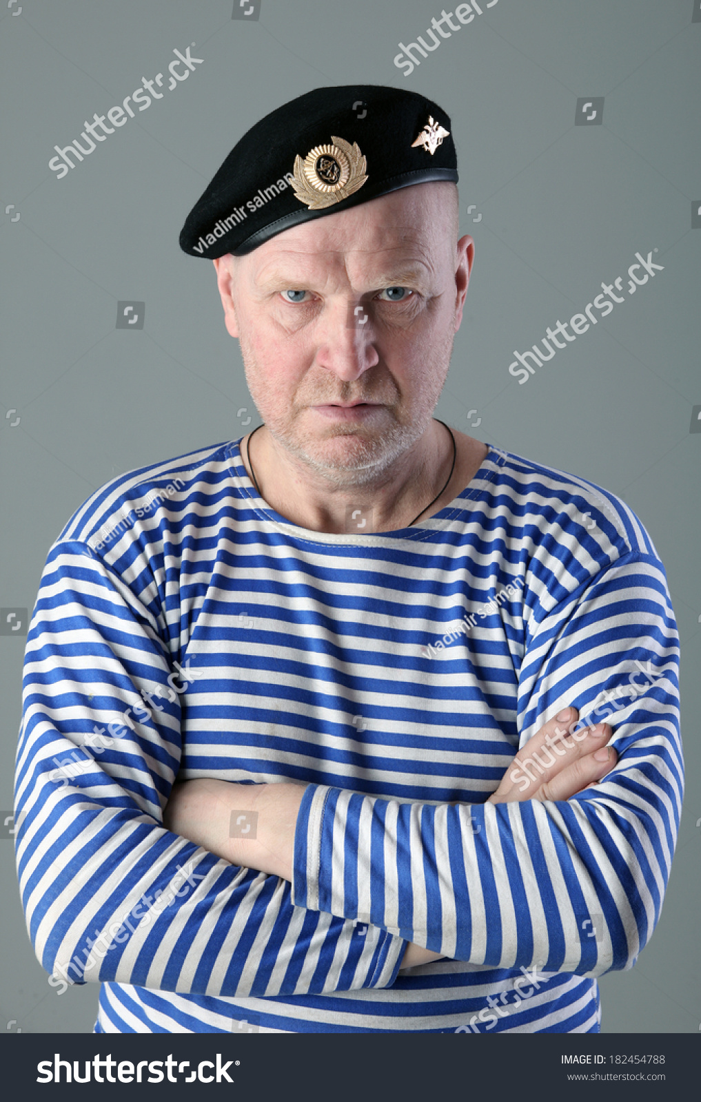 82e18278f1d12 close-up portrait of adult white men in striped vest and a black beret with