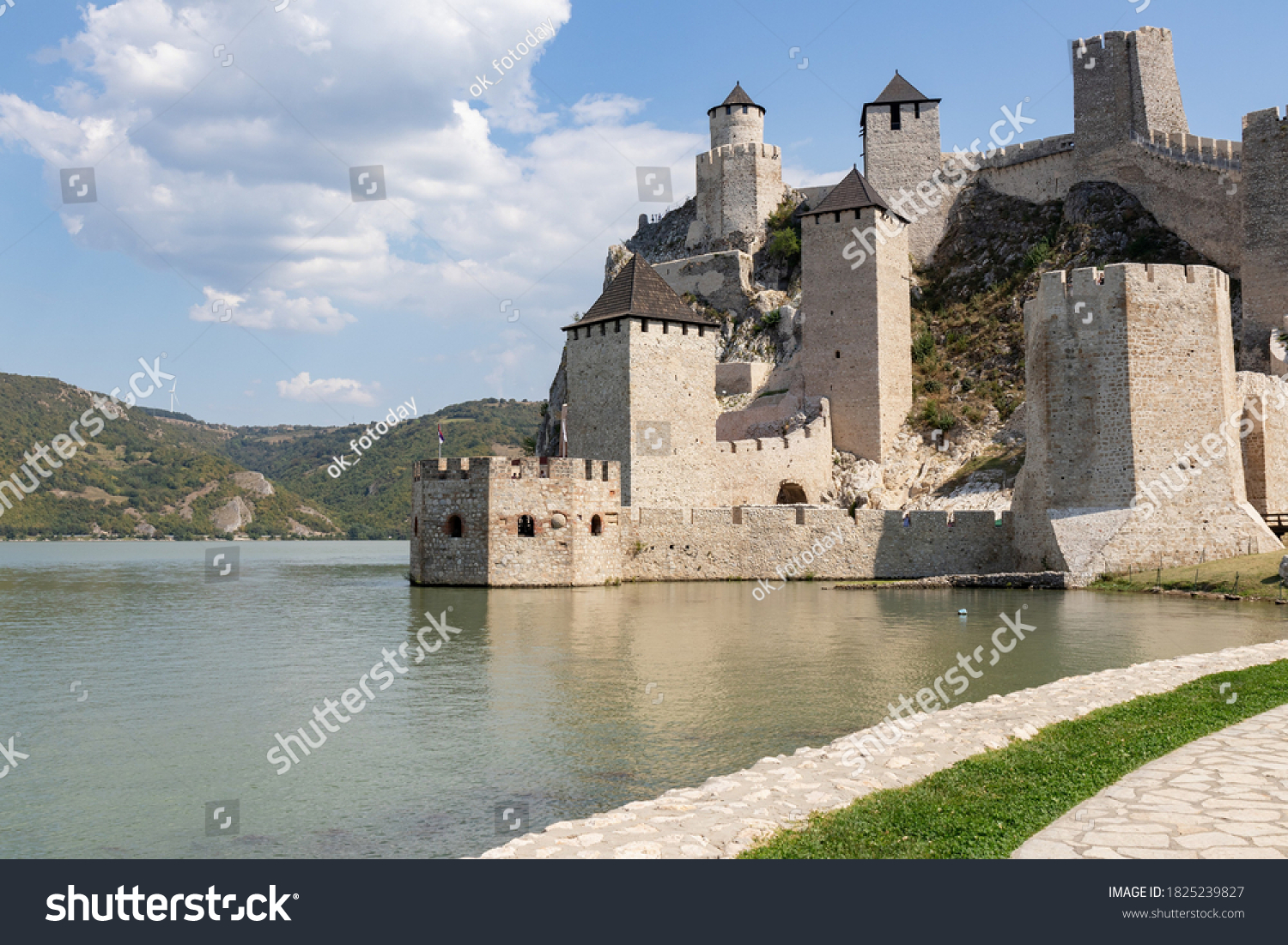 View of the Golubac fortress from the Danube bank on a sunny day. Serbia, Golubac, 13 September 2020