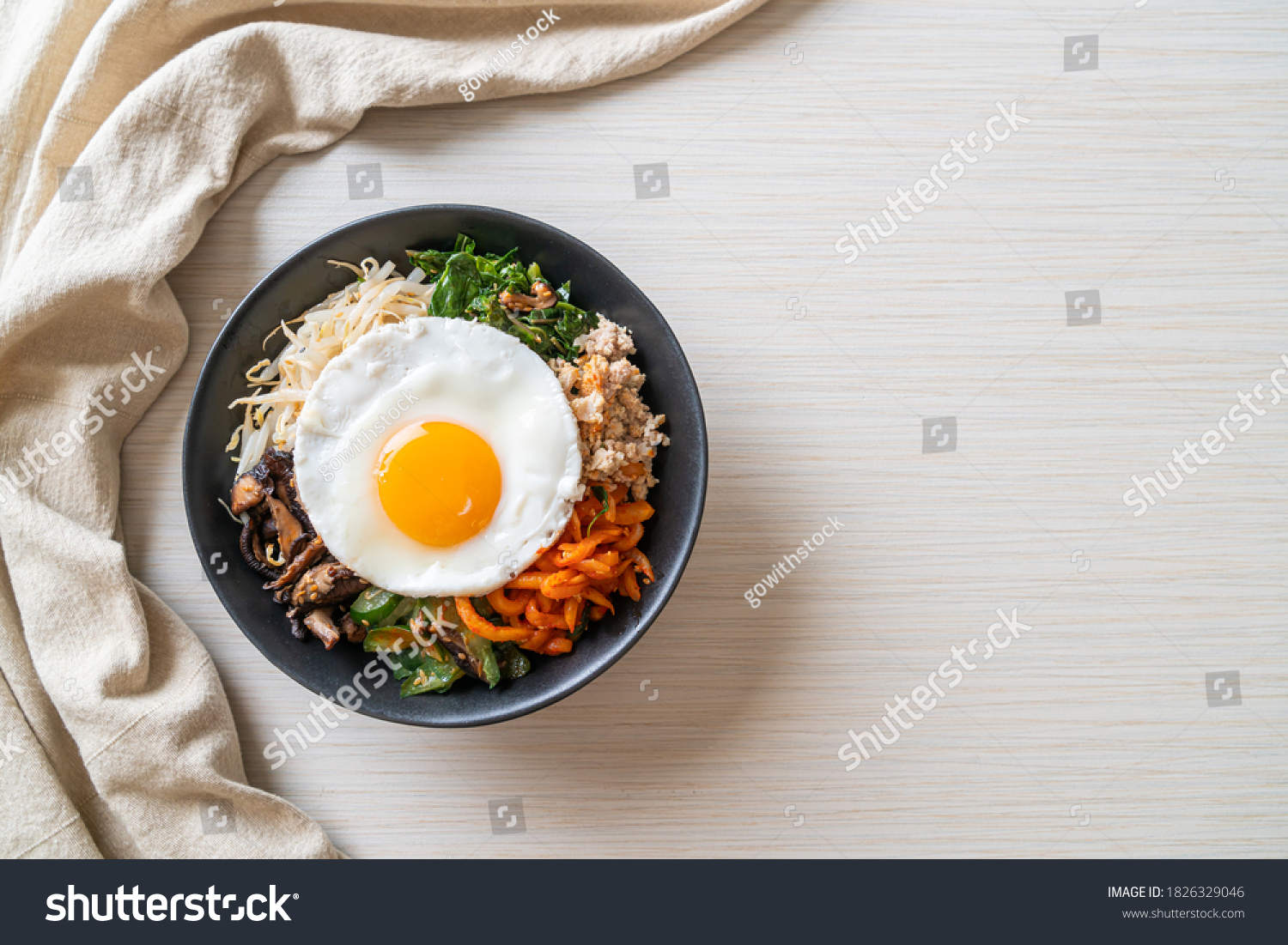 Bibimbap, Korean spicy salad with rice and fried egg - traditionally Korean food style #1826329046