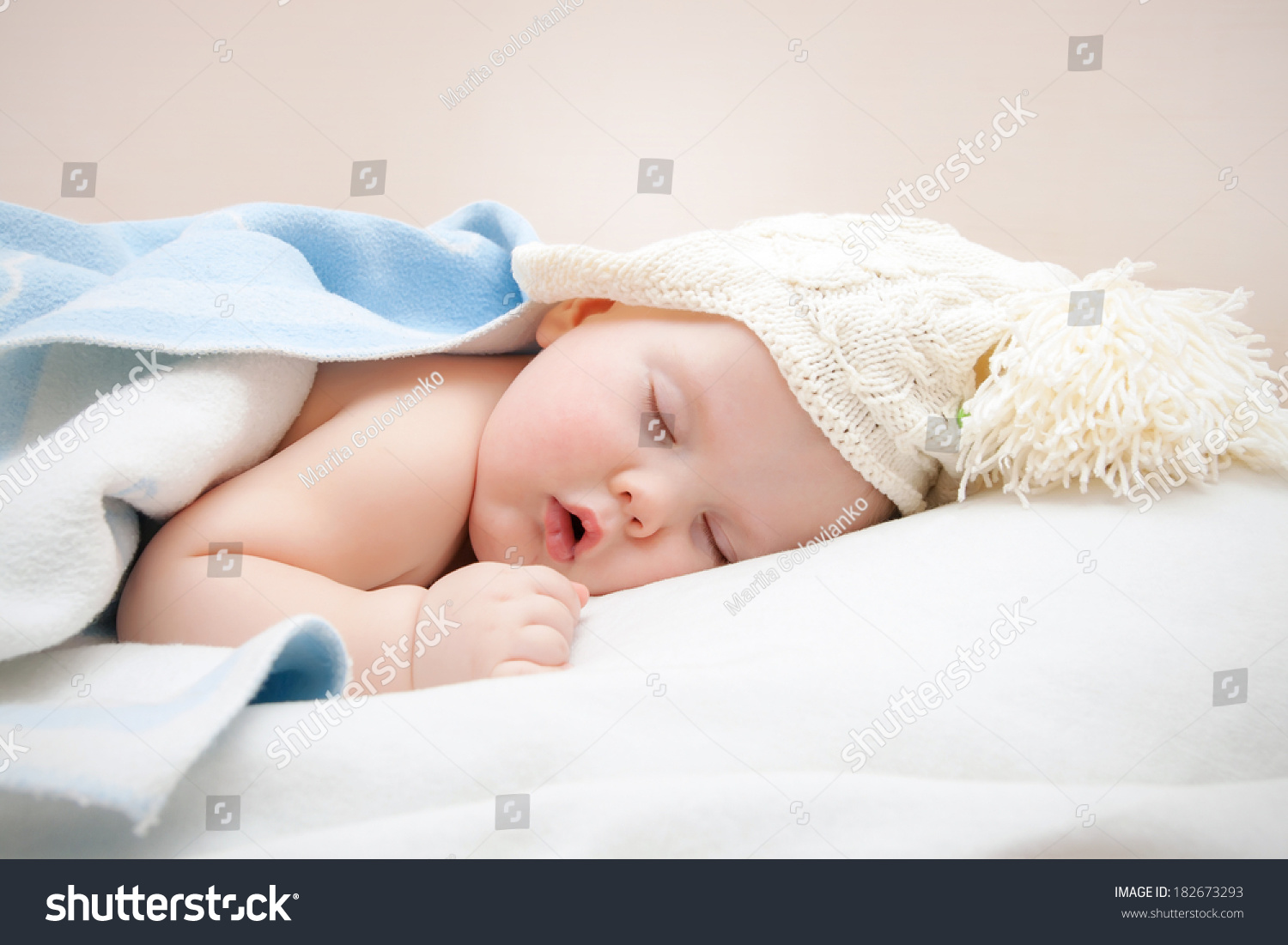 cute sleeping baby knitted hat pompom stock photo (edit now