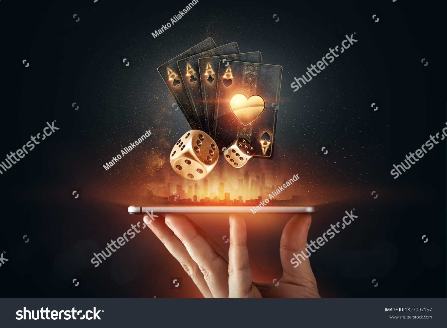 Creative background, online casino, in a man's hand a smartphone with playing cards, roulette and chips, black-gold background. Internet gambling concept. Copy space. #1827097157