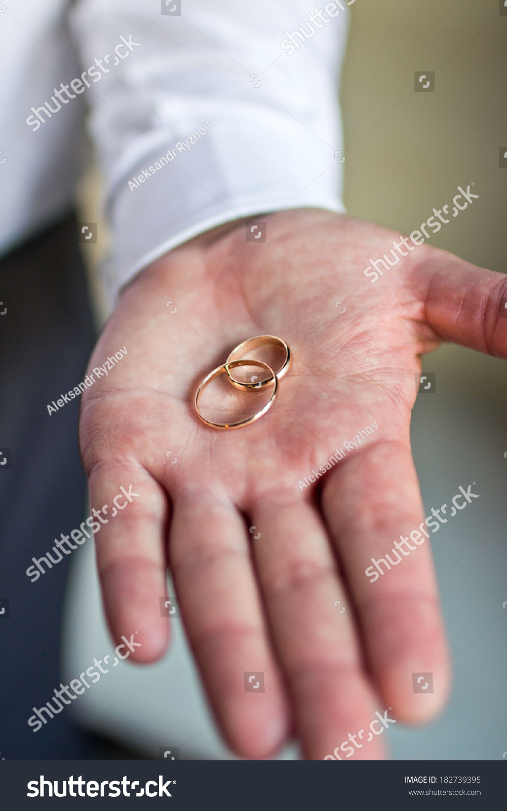 Two Wedding Rings Lie On Palm Stock Photo (Royalty Free) 182739395 ...