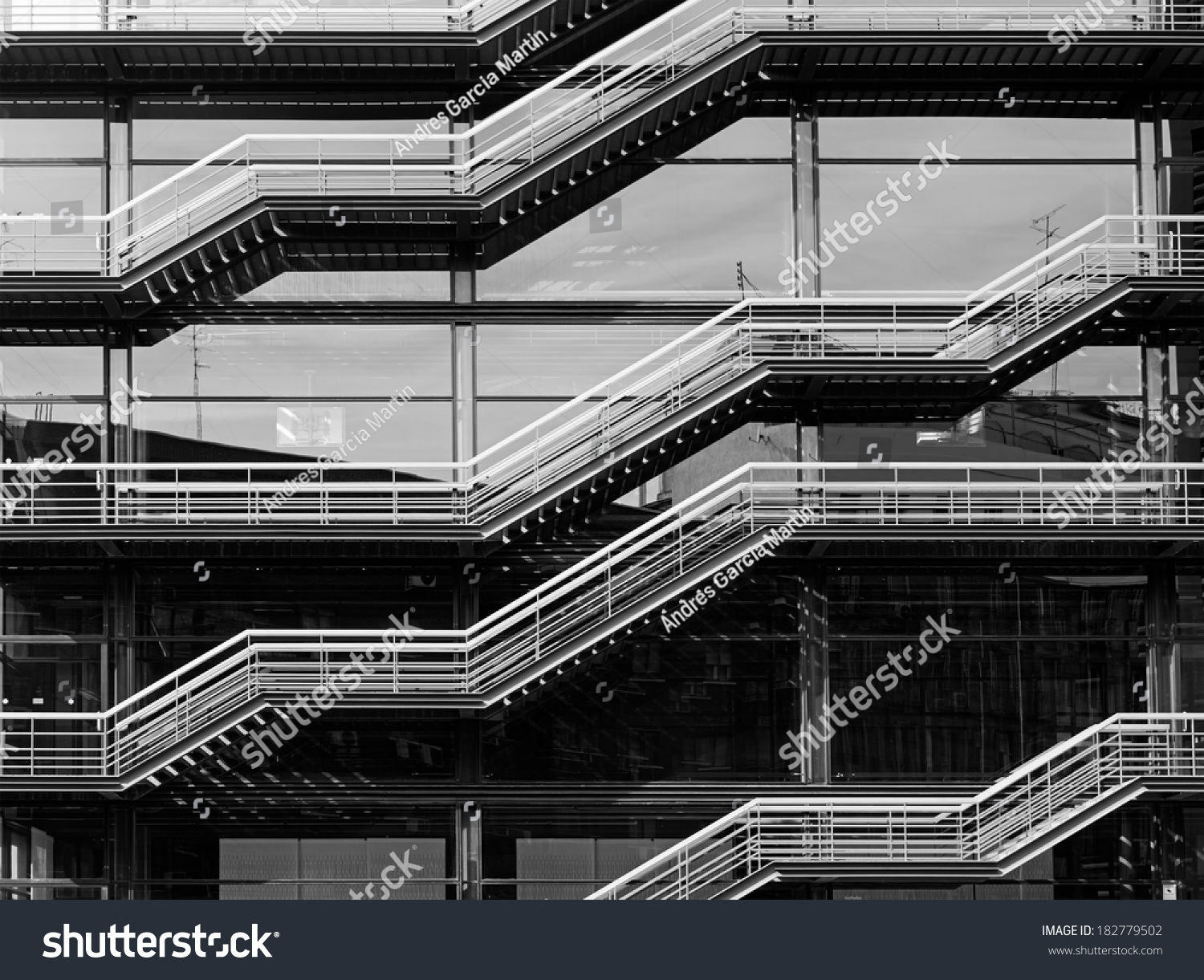 Stainless steel staircase against a glass wall in a modern building in madrid spain black and - Steel framing espana ...