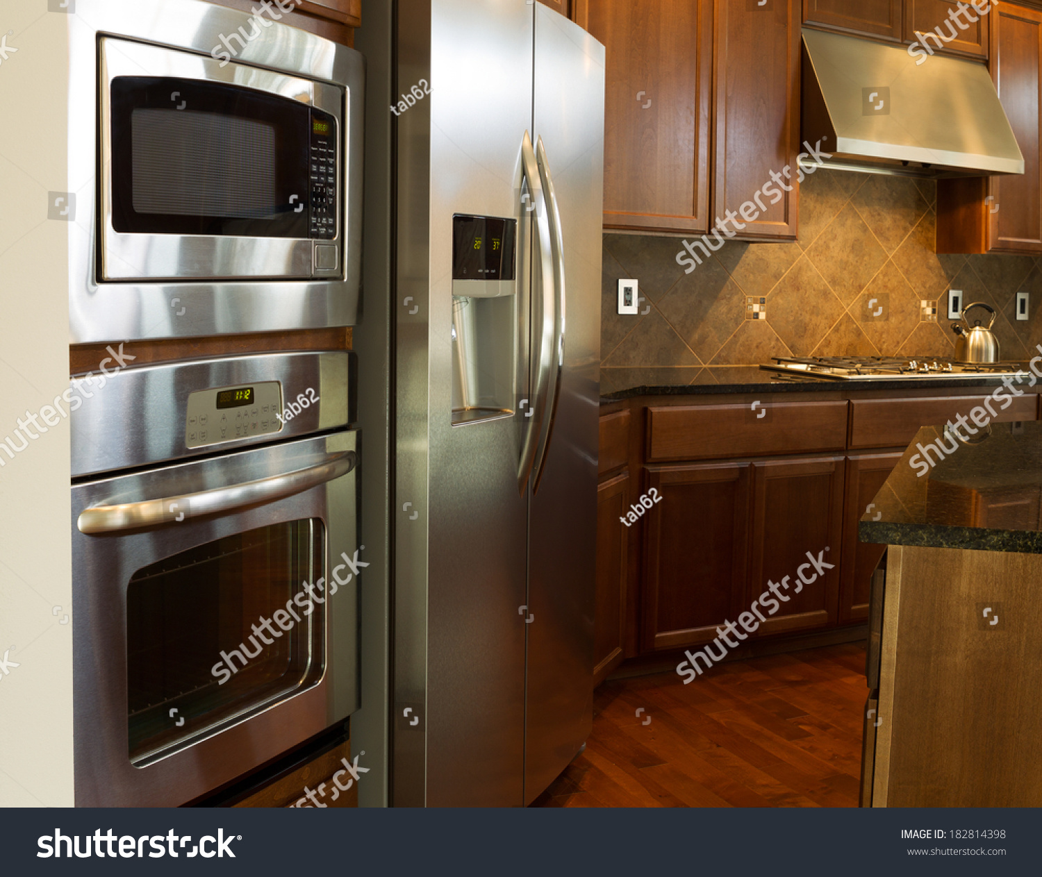 Stainless Steel Kitchen Cabinets With Oven: Closeup Photo Stainless Steel Appliances Modern Stock