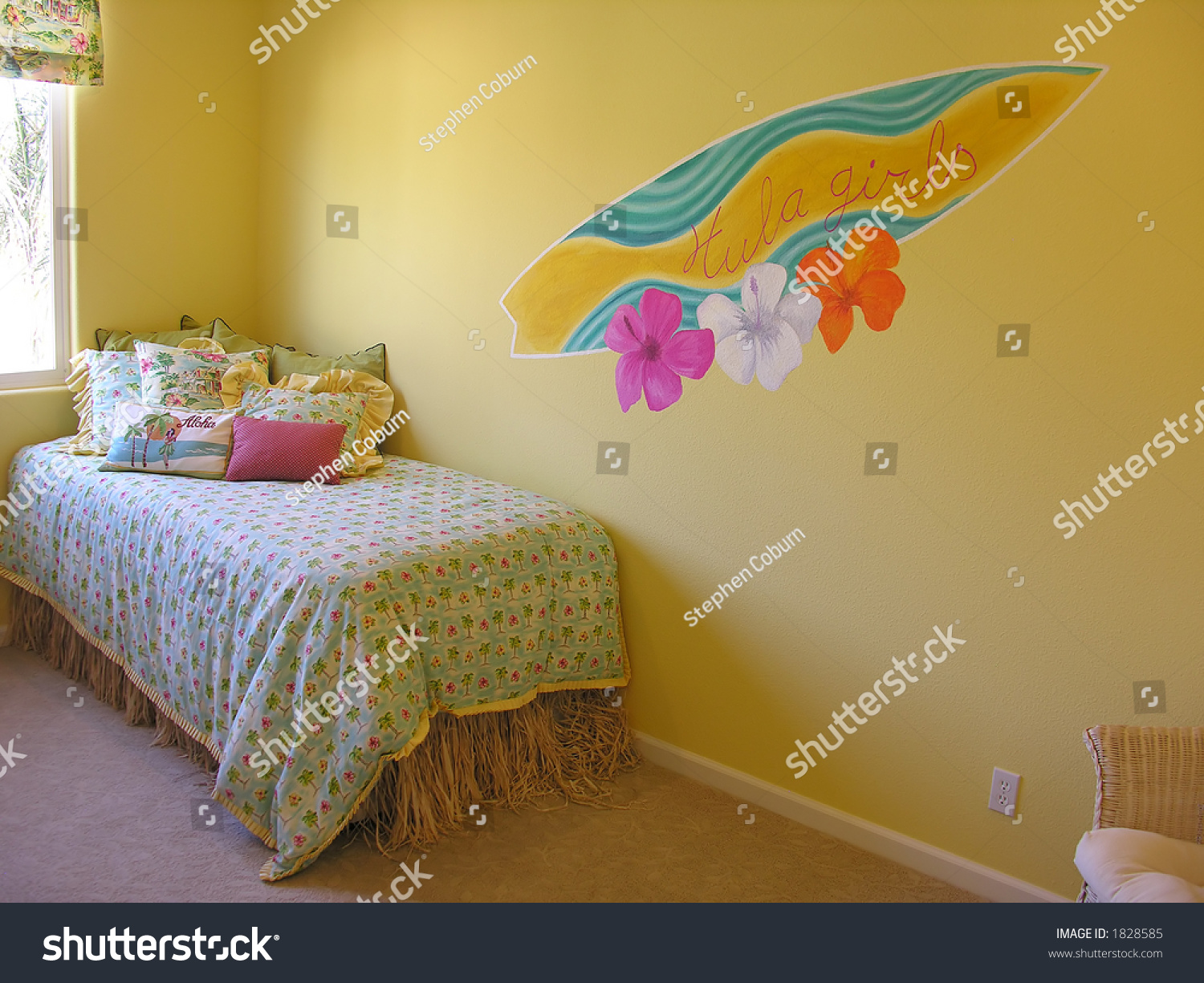 hawaiian themed bedroom with a surfboard painted on the wall stock