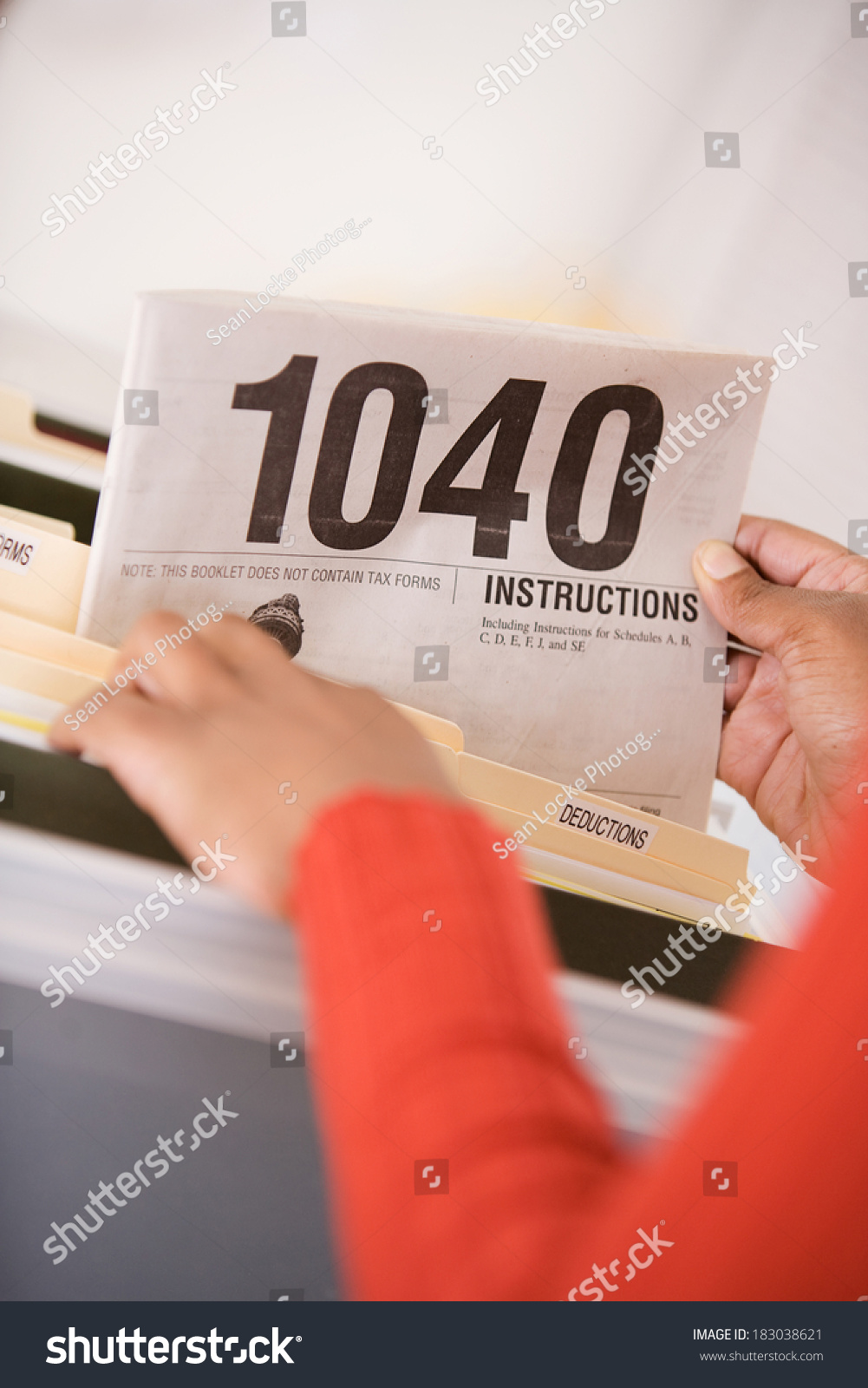 Taxes woman pulls out instructions 1040 stock photo 183038621 taxes woman pulls out instructions for 1040 tax form falaconquin