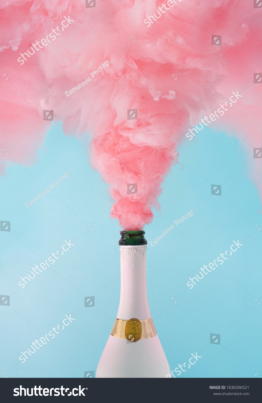 Pastel pink champagne explosion on blue background. Minimal party concept. New Year and Christmas celebration idea. #1830396521