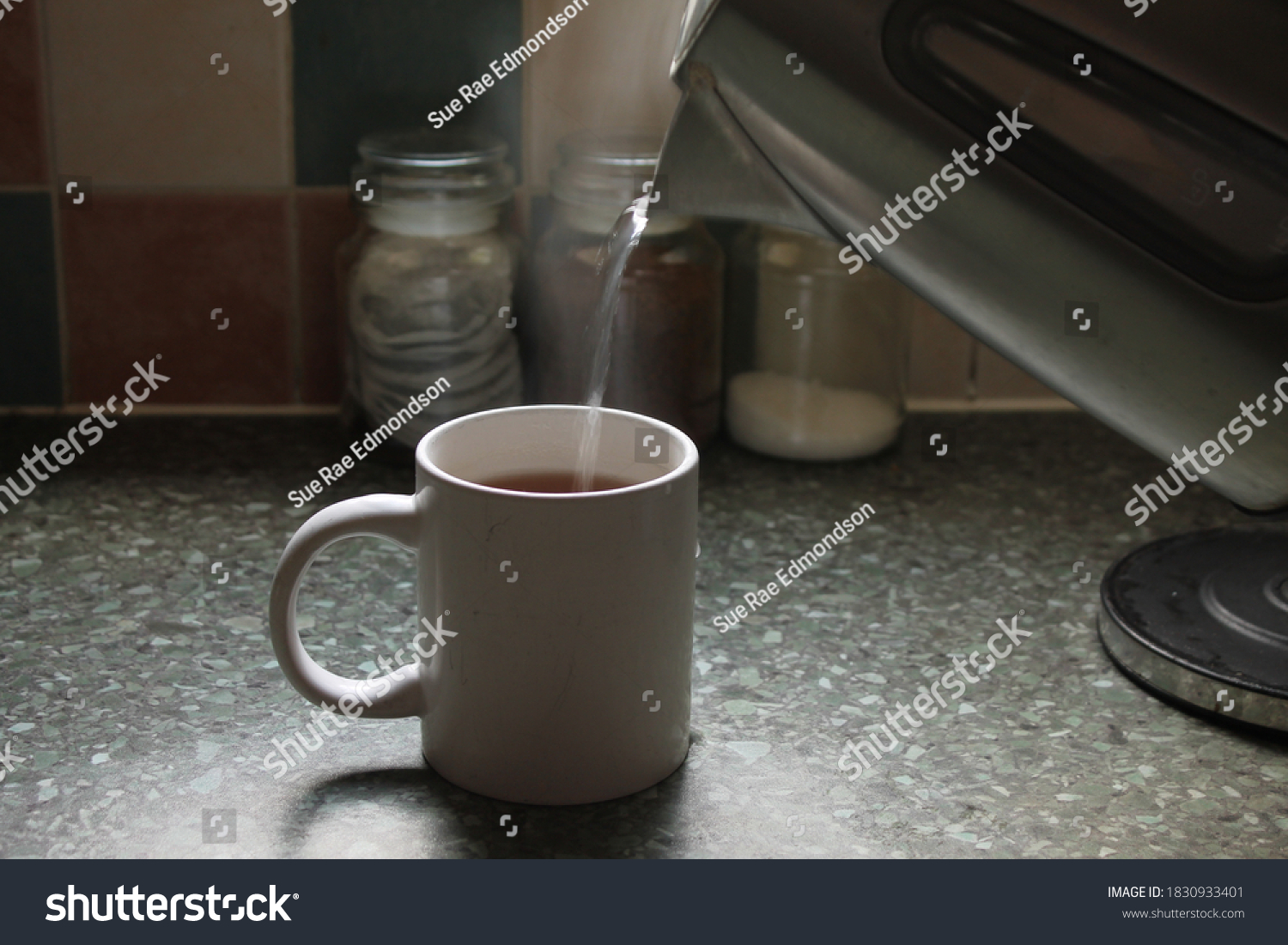 stock-photo-steaming-hot-water-being-pou
