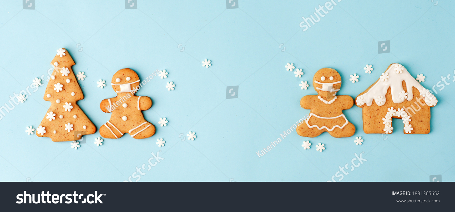 Happy New Year's set of numbers 2021, gingerbread man in face mask from ginger biscuits glazed sugar icing decoration on blue background, minimal seasonal pandemic winter holiday banner #1831365652