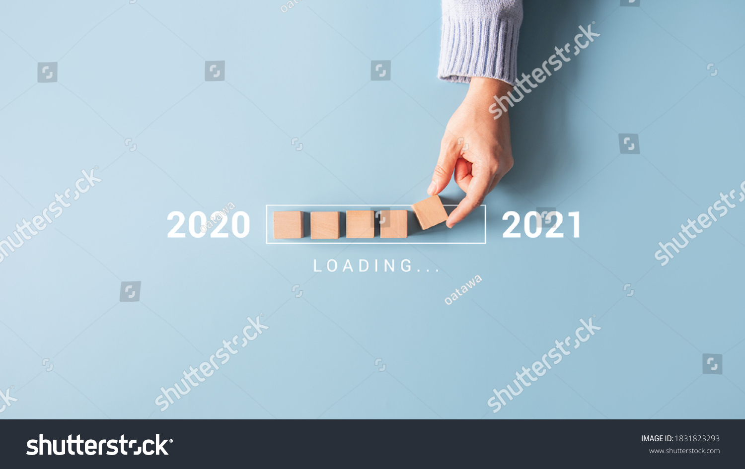 Loading new year 2020 to 2021 with hand putting wood cube in progress bar. #1831823293