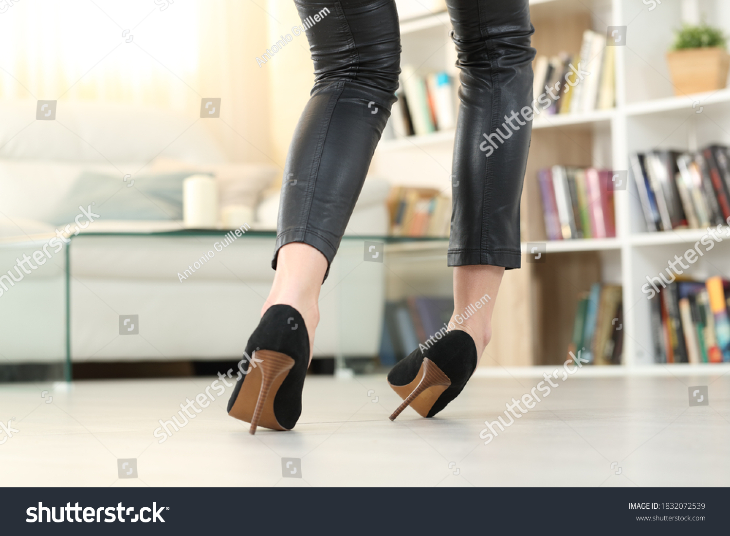 Back view of a Woman legs with high heels walking and sprain ankle #1832072539