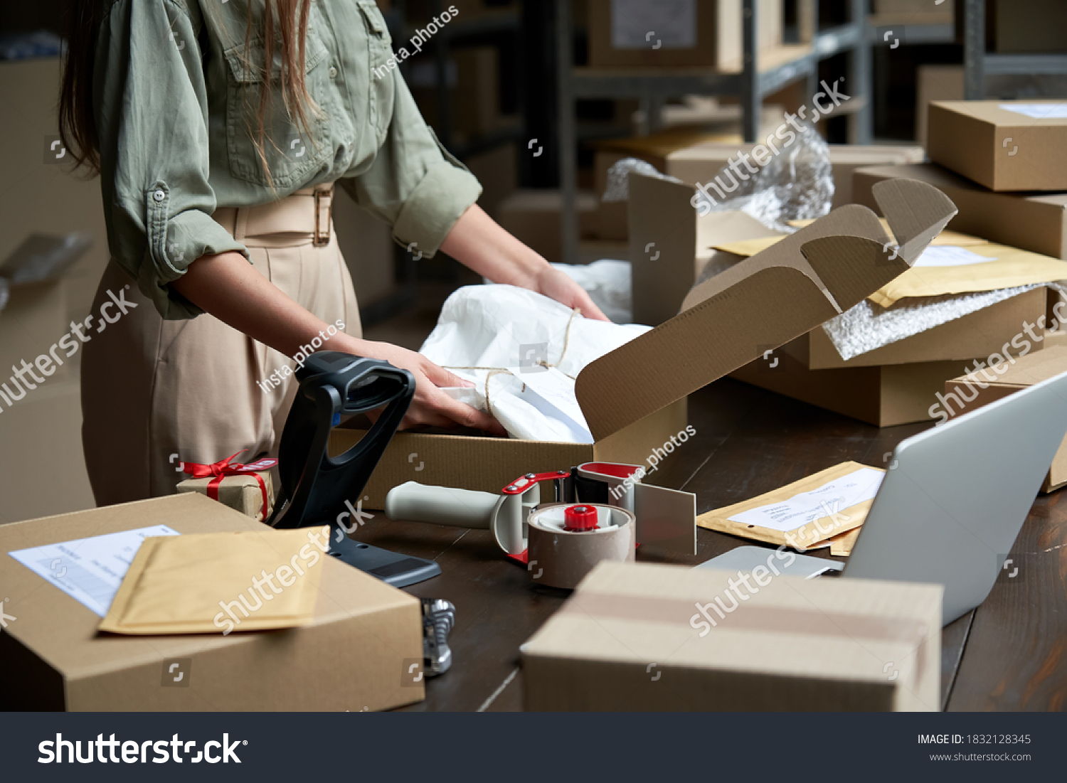 Closeup view of female online store small business owner seller entrepreneur packing package post shipping box preparing delivery parcel on table. Ecommerce dropshipping shipment service concept. #1832128345