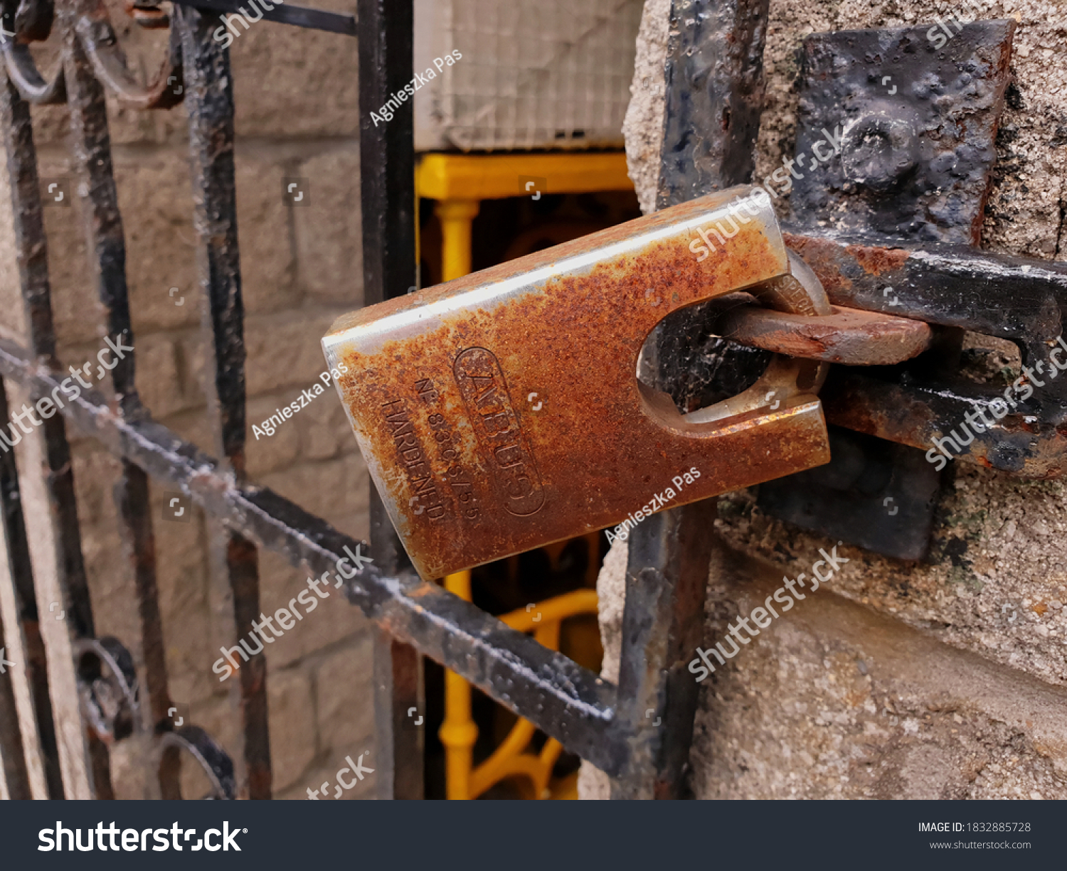 BRAY, CO. WICKLOW, IRELAND - AUGUST 09, 2020: Close up view of the closed rusty padlock. Closed entrance to the stadium of the Bray Wanderers Football Club in Bray, Ireland.