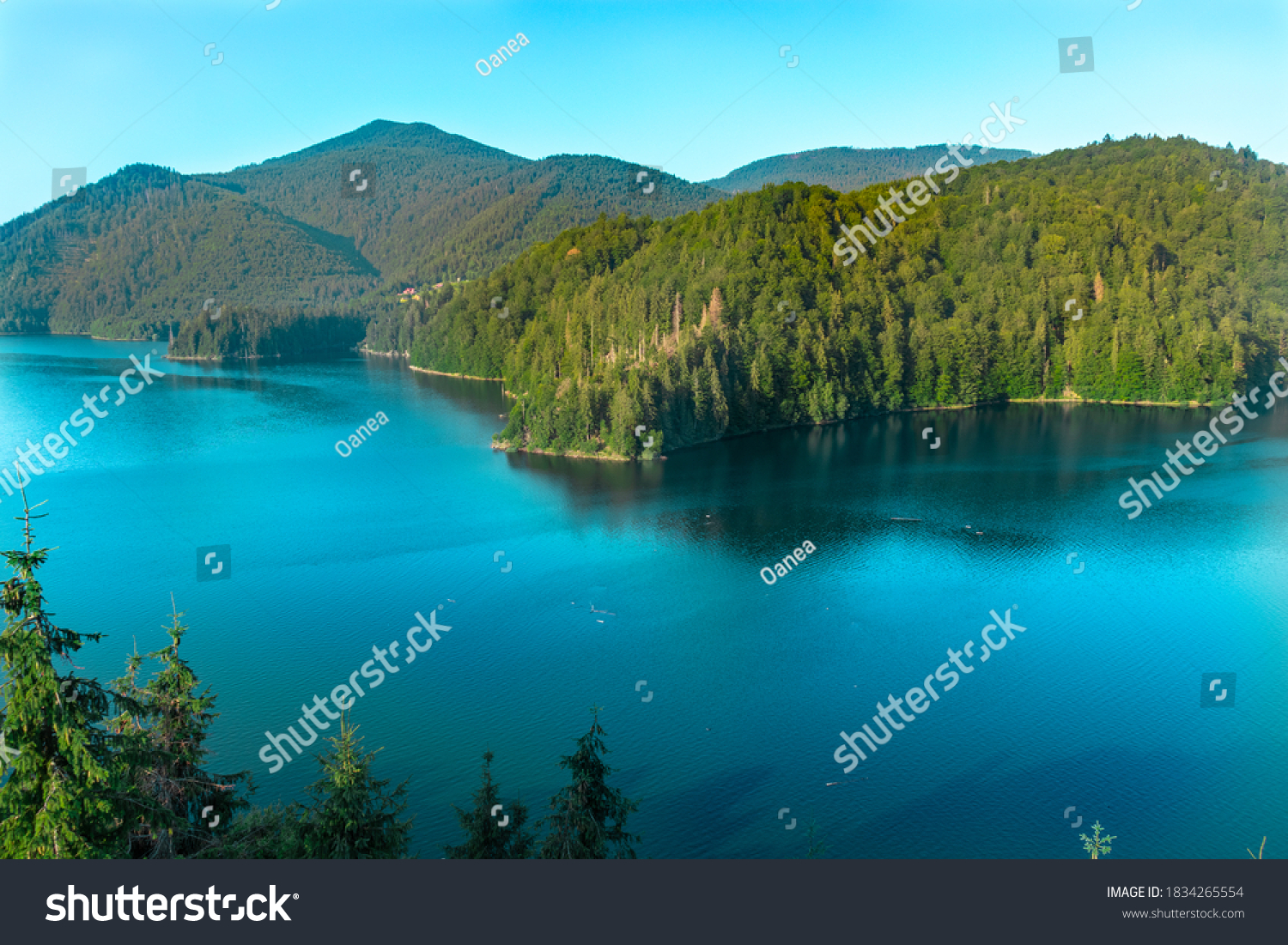 Mountain lake with clear water view from above